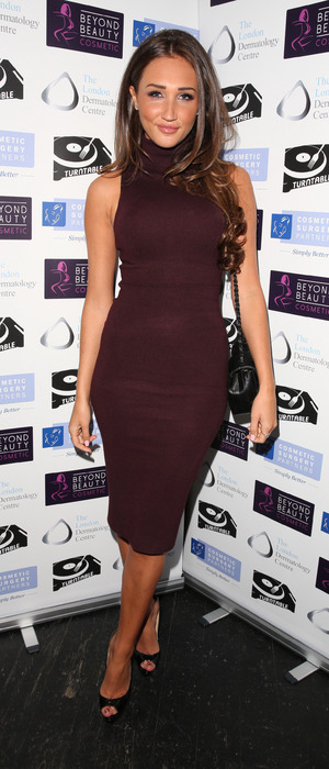 Megan McKenna wears burgundy dress, attends Turntable bar in Holborn, London, 9th December 2015