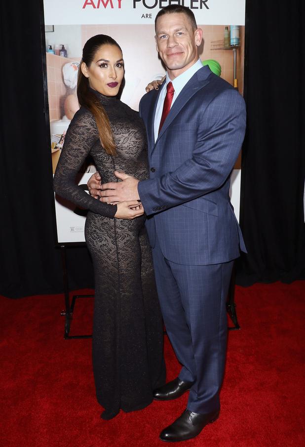 Total Divas star Nikki Bella and boyfriend John Cena at Sisters premiere, New York 8 December