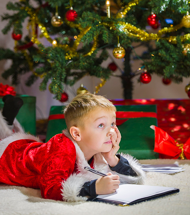 Model released - 5 year old boy writing a letter to Father Christmas 2013