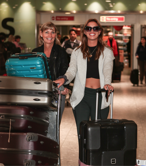 Winner of 'I'm a Celebrity, Get me Out of Here' Vicky Pattison arrives at Heathrow airport with runner-up Ferne McCann.