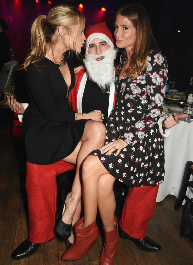 Laura Whitmore, Jack Guinness and Millie Mackintosh attend the launch of new pop-up restaurant The Glam Clam on December 16, 2015 in London, England.