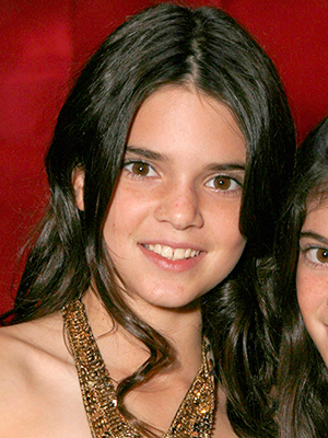 Kendall Jenner and Kylie Jenner pose for a photo at the 'Keeping Up With the Kardashians' viewing party at Chapter 8 Restaurant on October 16, 2007 in Agoura Hills, California. (Photo by Jeff Vespa/WireImage) *** Local Caption ***