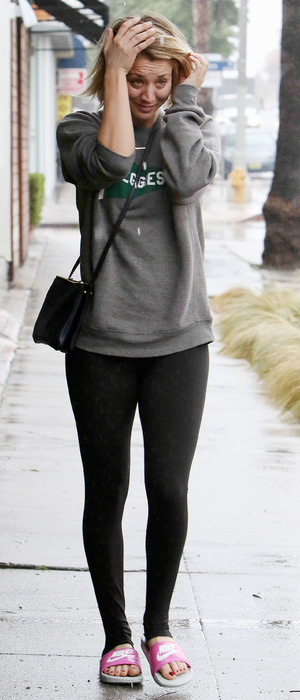 Kaley Cuoco gets caught in a downpour while out and about in Los Angeles, 23rd December 2015