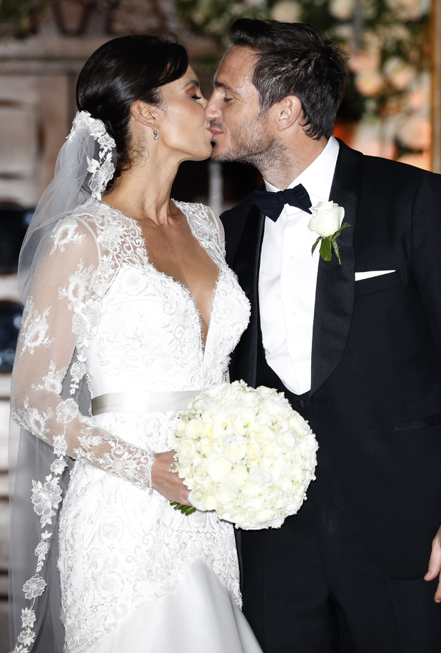 Frank Lampard and Christine Bleakley kiss on the steps of the St. Paul's Church after their wedding on December 20, 2015 in London, England.