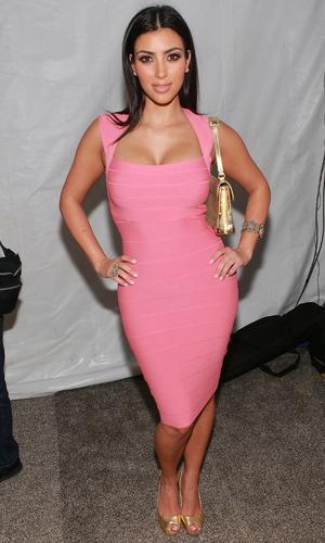 Kim Kardashian attends the Badgley Mischka swimwear fashion show at the Raleigh Hotel, Miami Beach 11 July 2007