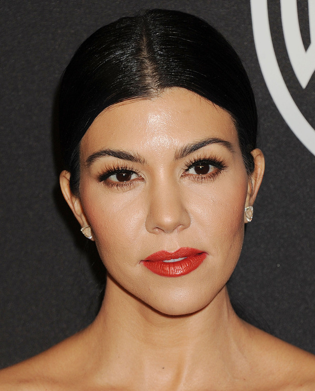 Kourtney Kardashian shows off her glossy red lips at the InStyle and Warner Bros Golden Globe party in Los Angeles, 11th January 2016