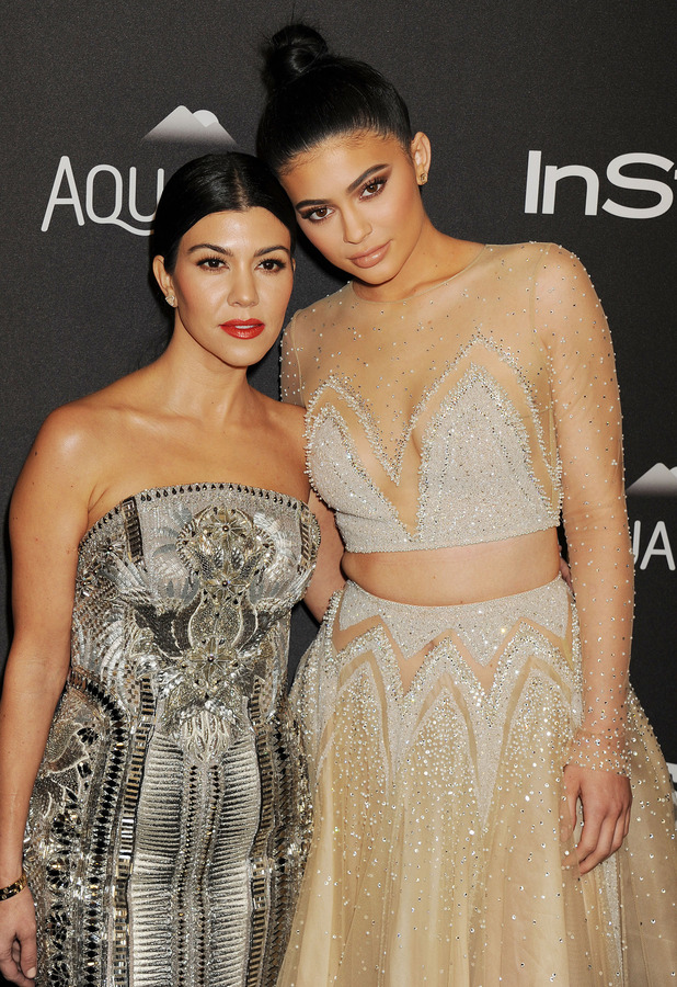 Kourtney Kardashian poses with sister Kylie Jenner at the InStyle and Warner Bros Golden Globes Awards in Los Angeles, 11th January 2016