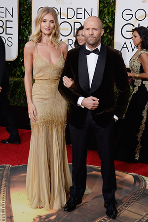 Rosie Huntington-Whiteley (L) and actor Jason Statham arrive to the 73rd Annual Golden Globe Awards held at the Beverly Hilton Hotel on January 10, 2016.