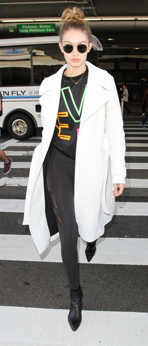 Gigi Hadid spotted in white coat at L.A.X International airport, Los Angeles, 29th January 2016