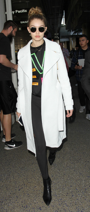 Model Gigi Hadid spotted in white coat at L.A.X International airport after walking in Paris Fashion Week, Los Angeles, 29th January 2016