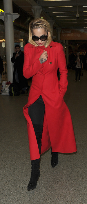Rita Ora arriving in London via Eurostar from Paris, wearing red coat and black boots, 27th January 2016