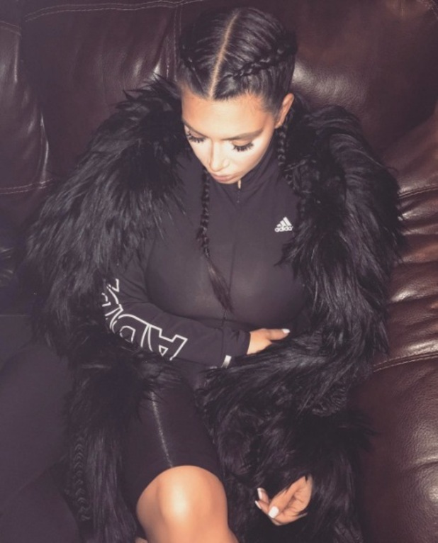 Kim Kardashian poses for picture, wearing her hair in braids, Instagram, 27th January 2016