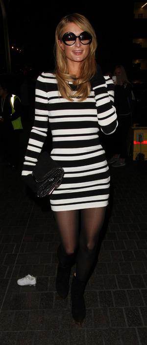 Paris Hilton wears stripy jumper dress at L.A.X in Los Angeles 4th February 2016