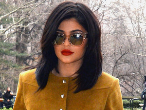 Keeping Up With The Kardashians star Kylie Jenner spotted out and about in New York City wearing suede dress and matching boots, 9th February 2016