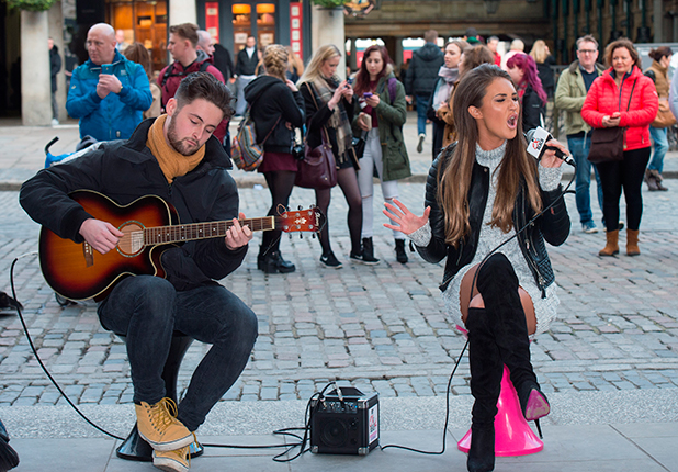 Celebrity Big Brother and Ex on the Beach star, Megan McKenna busking in Covent Garden Piazza, London