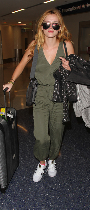 Bella Thorne proves in-slight fashion credentials in khaki jumpsuit at L.A.X Airport in Los Angeles, 17th February 2016