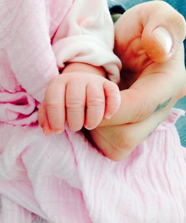 Kirk Norcross shares photo of his baby daughter Violett's hands - 16 February 2016.