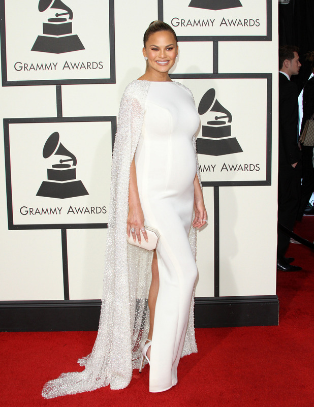 Chrissy Teigen wears white gown on the red carpet at the Grammy Awards in Los Angeles, 16th February 2016