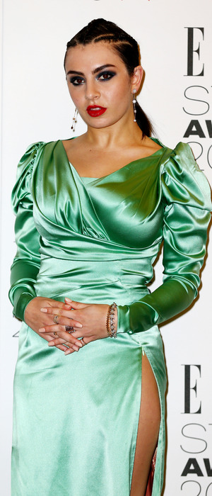 Singer Charli XCX wears elaborate green dress to the ELLE Style Awards in London, 23rd February 2016