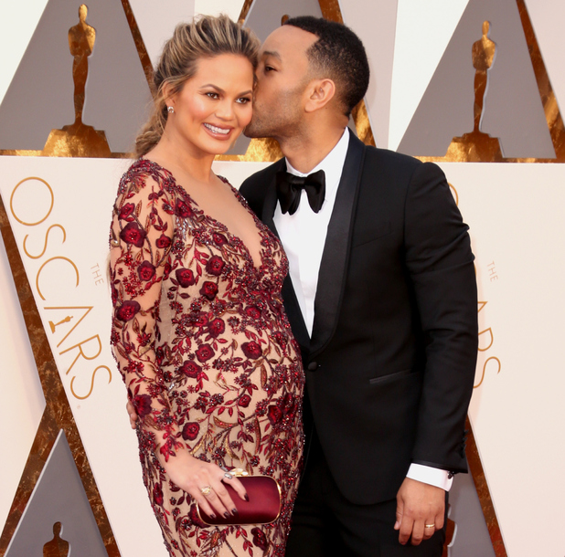 Chrissy Teigen and musician John Legend attend the 88th Annual Academy Awards at Hollywood & Highland Center on February 28, 2016 in Hollywood, California.