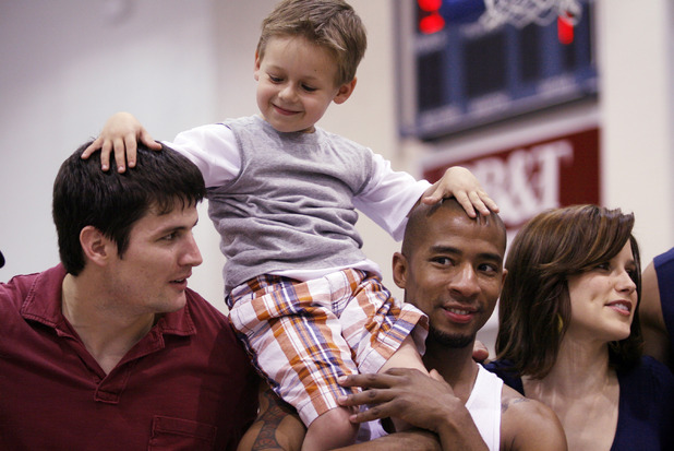 James Lafferty (L) and Antwon Tanner give Jackson Brundage a lift during the 5th Annual James Lafferty/One Tree Hill Charity Basketball Game, April 26, 2008 in Wilmington, North Carolina.