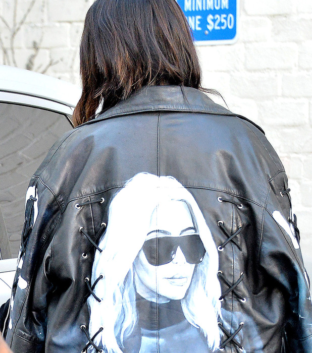 Kim Kardashian wears her face on the back of her biker jacket, Los Angeles, America, 17th March 2016