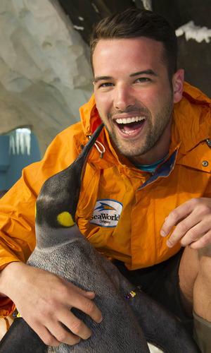 Ricky Rayment meets Sherlock the penguin at Sea World Orlando 22 March