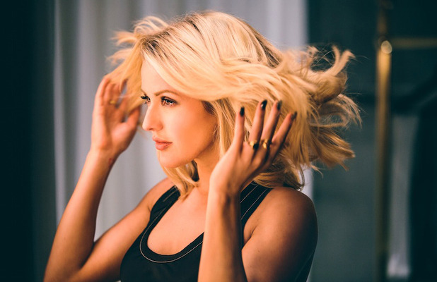 Ellie Goulding teams up with Pantene Pro V for #strongisbeautiful campaign, wearing black vest and lob, 22nd March 2016