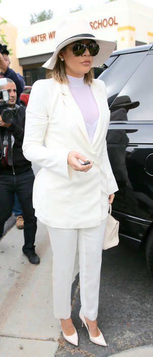 Khloe Kardashian glams up in white suit for Easter Sunday church service, 27th March 2016