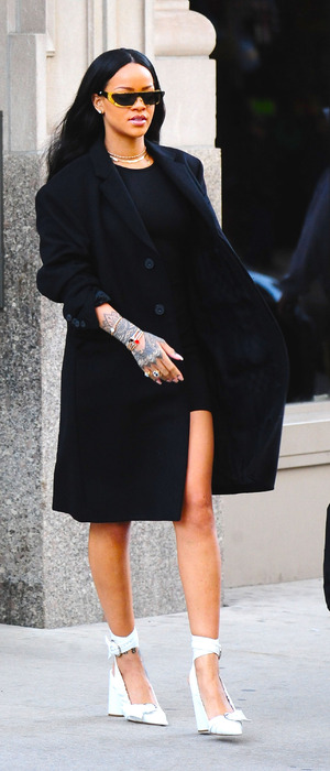 Singer songwriter Rihanna wears black and white ensemble while out and about in New York, 31st March 2016