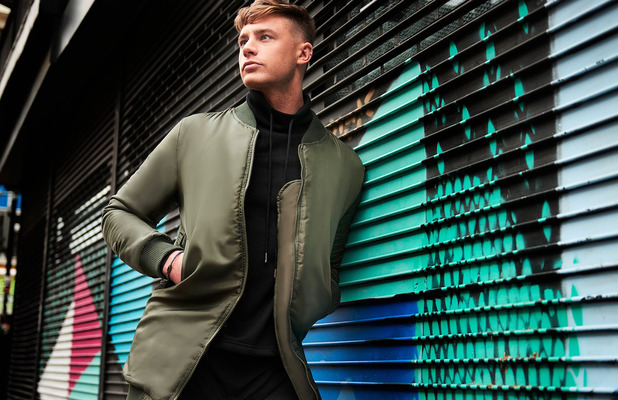 Geordie Shore's Scotty T is announced as the new face of BoohooMAN, wearing green bomber jacket 31st March 2016