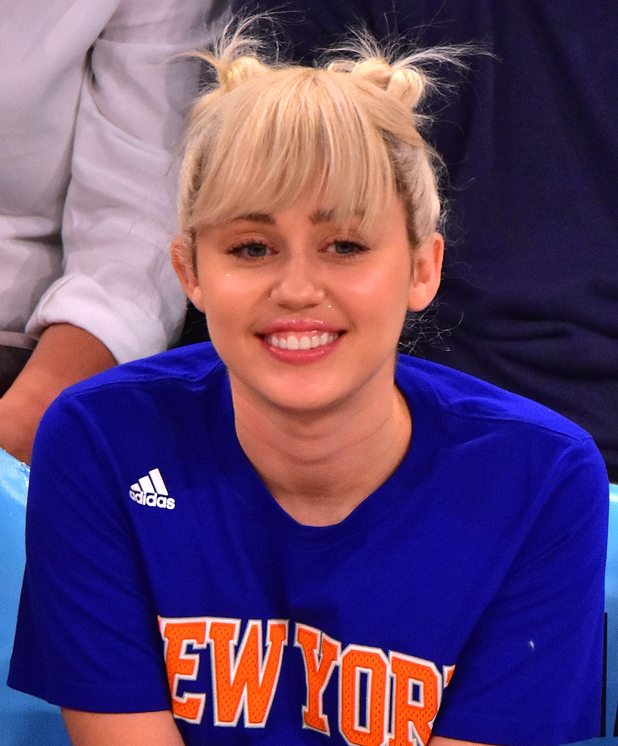 Miley Cyrus attends the Cleveland Cavaliers vs New York Knicks game at Madison Square Garden on March 26, 2016 in New York City.