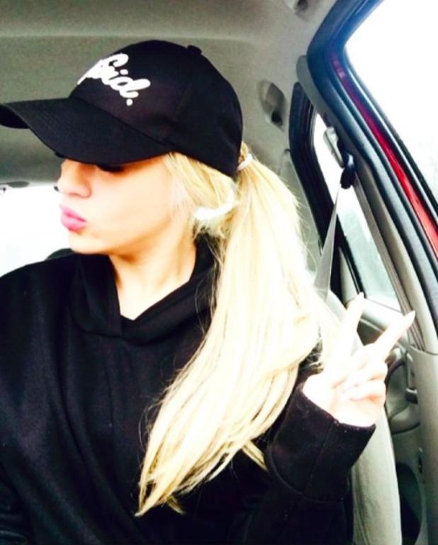 Stephanie Davis hides new long tresses under black cap, 2 April 2016.