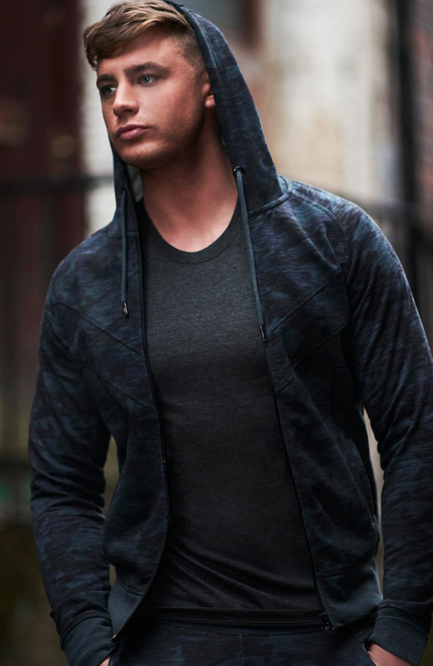 Geordie Shore's Scotty T is announced as the new face of BoohooMAN, wearing navy hoodie 31st March 2016