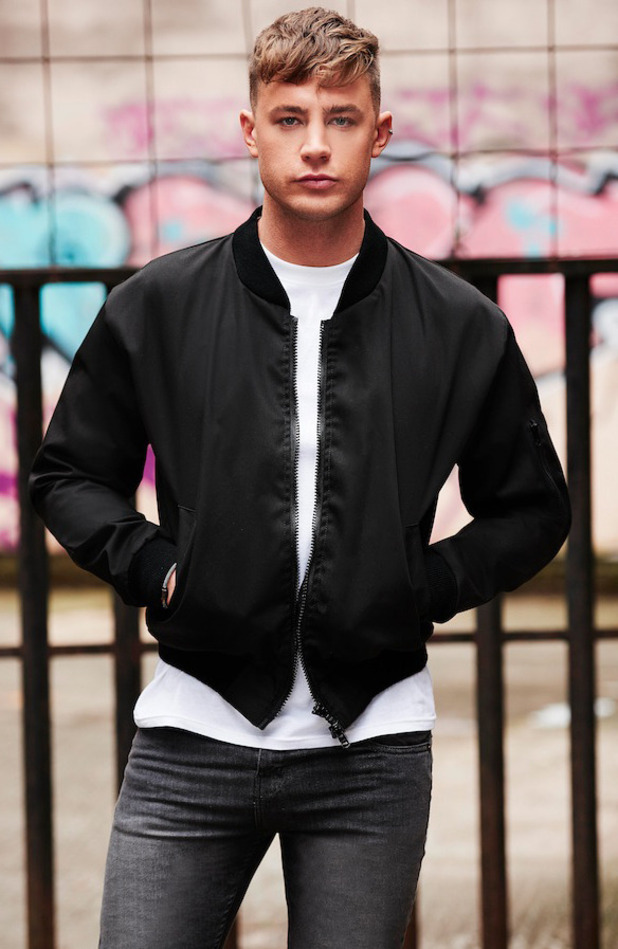 Geordie Shore's Scotty T is announced as the new face of BoohooMAN, wearing black bomber jacket 31st March 2016