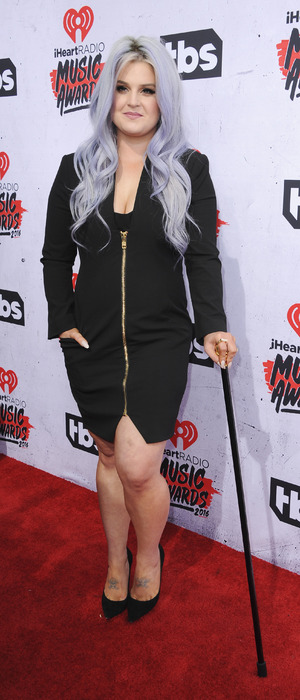 Kelly Osbourne uses cane at the iHeartRadio Awards at The Forum in Los Angeles, 3rd April 2016