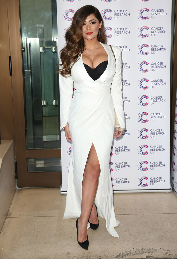 Celebrity Big Brother star Casey Batchelor shows off her cleavage in white dress at the Jog On To Cancer event in London, 7th April 2017