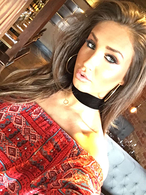 TOWIE's Megan McKenna poses for Snapchat selfie 6 April 2016