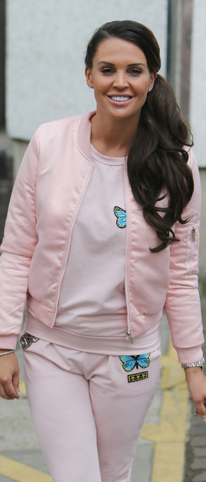 Danielle Lloyd wear all-pink tracksuit set, matching bomber jacket and trainers to the ITV Studios in London, 14th April 2016