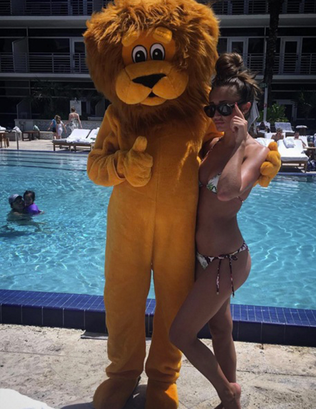 TOWIE's Megan McKenna finds a 'bae' in Miami - a lion mascot! April 2016