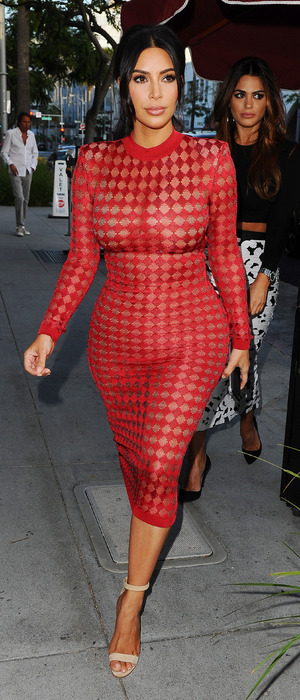 Kim Kardashian wears daring see-through red dress to Naomi Campbell's book launch in Los Angeles, 28th April 2016