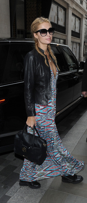 Heiress Paris Hilton lands in London wearing maxi dress and boots, 27th April 2016