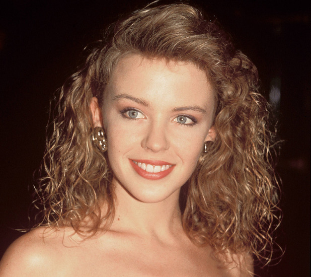 Kylie Minogue sporting a perm in the 1980s, 25th April