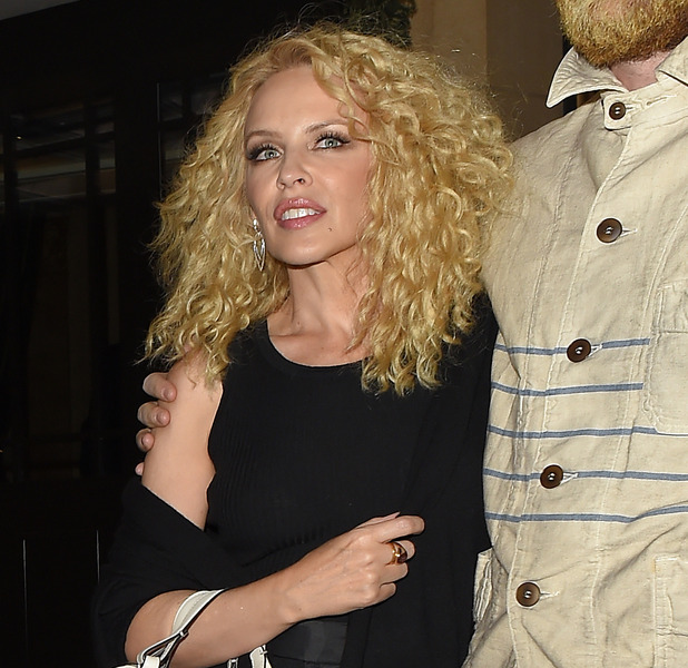 Kylie Minogue is unrecognisable as she leaved The Dorchester hotel in London alongside Joshua Sasse with new perm, 24th April 2016