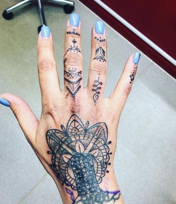 Jodie Marsh gets hand tattoo. 24 April 2016.