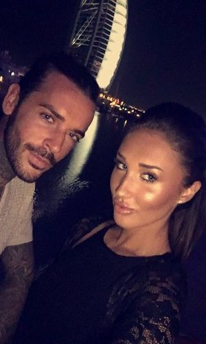 Megan McKenna and Pete Wicks pose in front of the Dubai sail on holiday - 3 May 2016