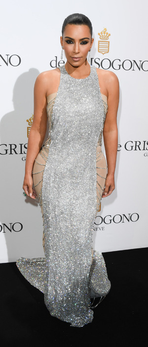Keeping Up With The Kardashians star Kim Kardashian poses in silver dress at the De Grisogono Party, 69th Cannes Film Festival, Cannes, France, 17th May 2016