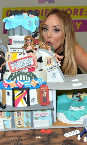 Charlotte Crosby with cake for 5th birthday Celebrations of 'Geordie Shore' at MTV London on May 24, 2016 in London, England.