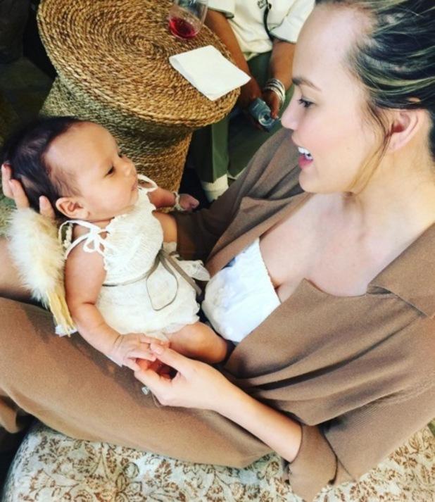 Chrissy Teigen and daughter Luna wearing angel wings 30 May