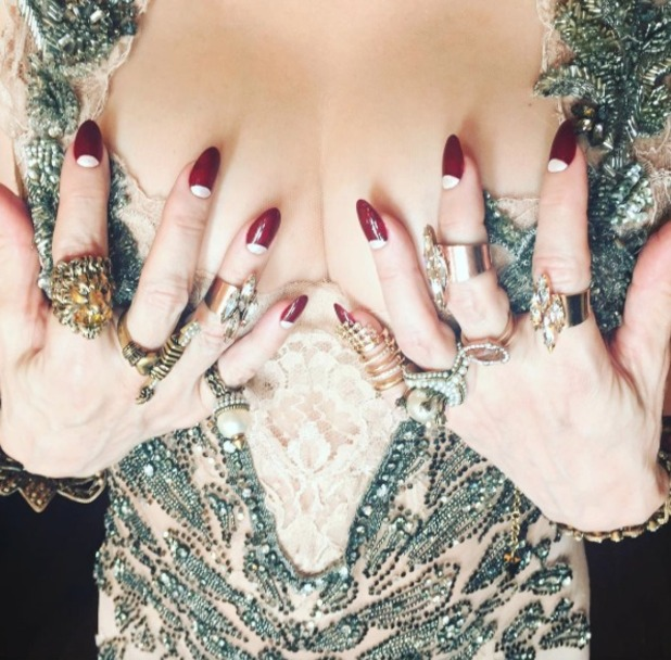 Madonna shows off deep red nails with silver half-moons, 8 June 2016